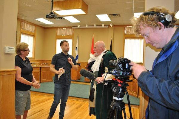 New Glasgow town crier Jim Stewart helps out a Scottish TV show crew by holding the microphone while they interview local historian Lynn MacLean. They were in Pictou County this week to find out about the connections between Scotland and New Scotland. CAROL DUNN – THE NEWS