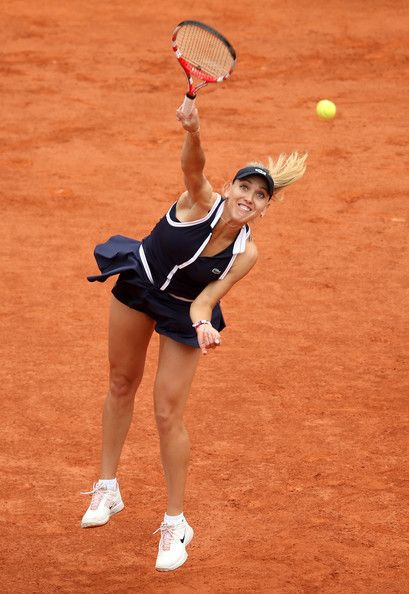 Elena Vesnina Photos - Elena Vesnina of Russia serves in her Women's Singles match against Victoria Azarenka of Belarus during day four of the French Open at Roland Garros on May 29, 2013 in Paris, France. - French Open: Day 4