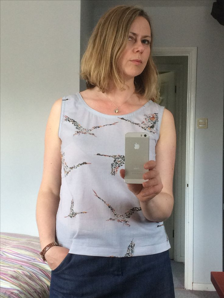 Simple Sleeveless Top with slightly lowered neckline.