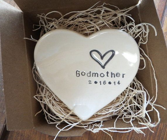 Your custom dish will require approx. 3 weeks to prepare for shipping. This attractive ring dish features the word Godmother and a heart. You can