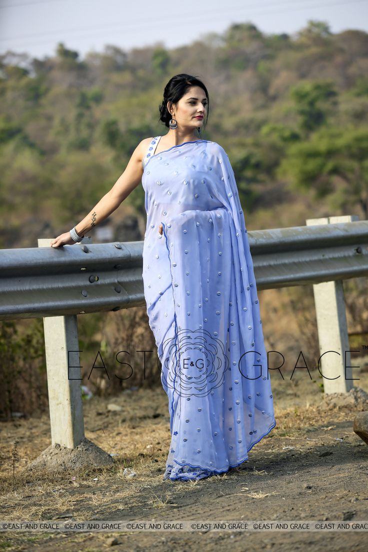 Featuring the Forget-Me-Not balmy blue 100% flat, pure silk chiffon saree, sprayed with shaded Forget-Me-Not florets on white net pleats and blue and silver half-moon handwork on the pallu for a stellar effect. The elegant wavy border is embroidered in silver. PRICE: INR 9,832.00; USD 148.97 To buy click here: https://www.eastandgrace.com/products/forget-me-not For help reach us at care@eastandgrace.com. With love www.eastandgrace.com