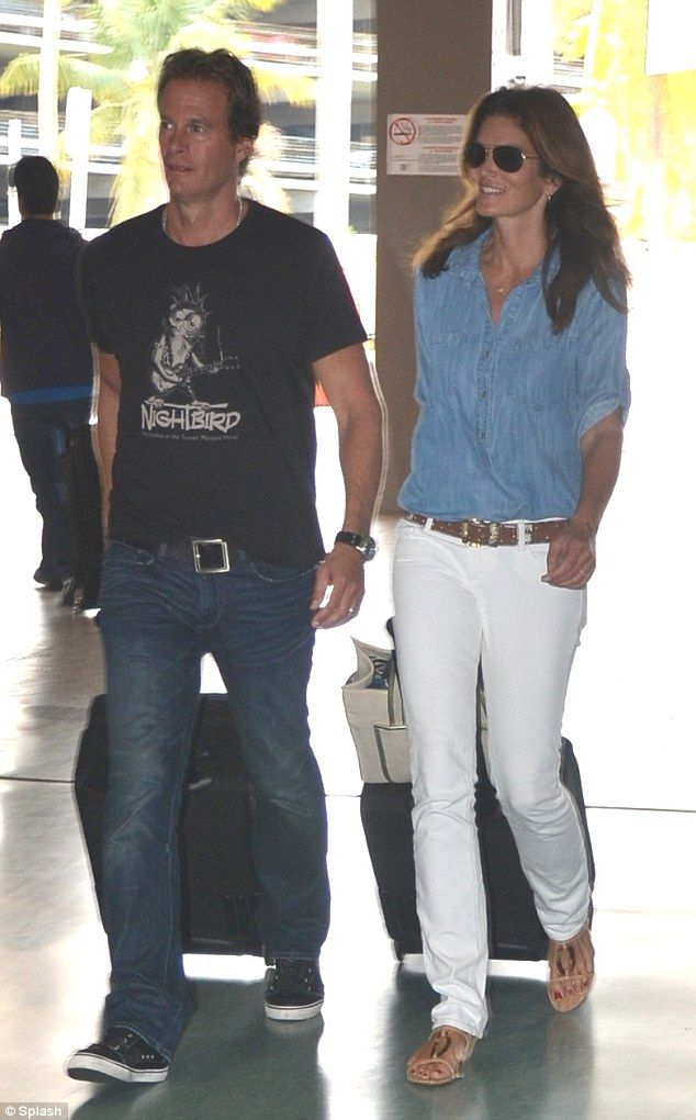 Fashion breeze: Cindy looked beachy cool in white jeans, blue top and strappy sandals