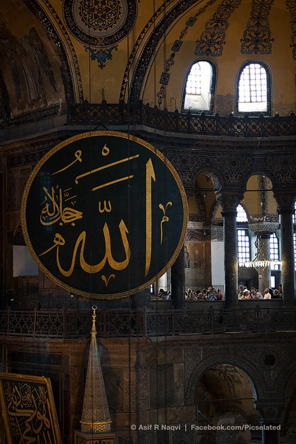Beautiful Arabic calligraphy, Allah (God) inscription Hagia Sophia/Ayasofya, Istanbul, Turkey. Arab caligraphy as an aspect of Arab Islamic art is similar to the arabesque in its careful symmetry and flow, an expression of the divine.