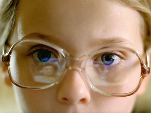 """Little Miss Sunshine"" - I like the reflection on the little girl's glasses."