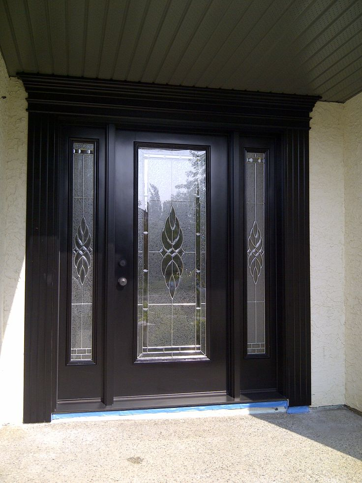Custom Trim work: Completed, this front entrance has a presence and a personality.