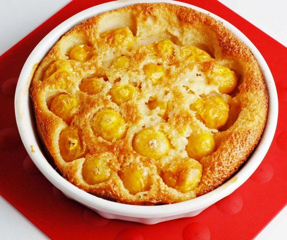 Tart ground cherries compliment a sweet almond and custard like filling in a somewhat traditional French Clafoutis.  Traditional French Clafoutis is made using fresh cherries with their pits still in.  The pits give the dessert the slight almond taste.  Ground cherries do not have pits so the addition of almond flavoring is required.