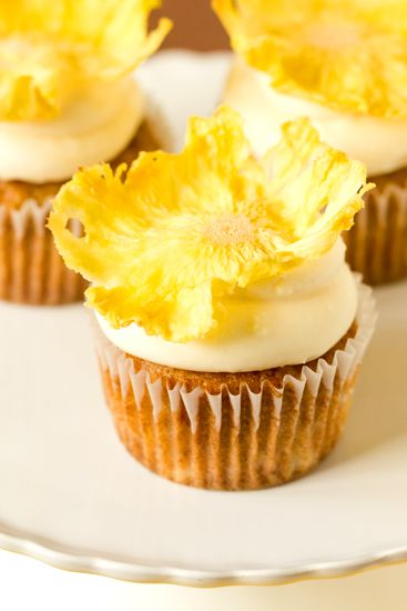 Hummingbird Cupcakes by Brown Eyed Baker=Intrigued. And really like those flowers on top (they're dried pineapple.)