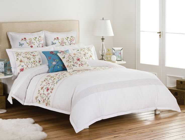 The Giselle quilt cover is inspired by the colour and details of Japanese textile deigns. Beautifully embroidered with blossoms, birds and butterflies, this stunning quilt cover is complemented by rows of subtle embroidery and pintuck detailing.