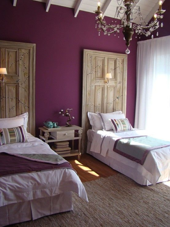 purple walls with birch-colored framed doors for headboards