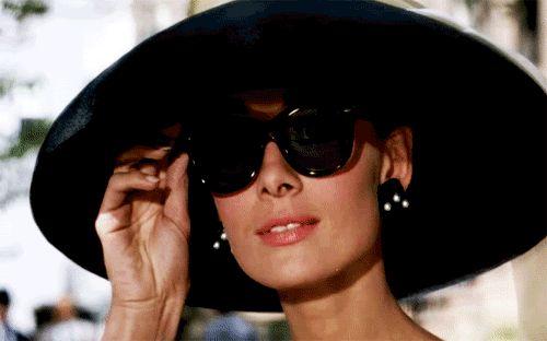 Hepburn. Lifting shades. In reverse.Breakfast at Tiffany's. '61.