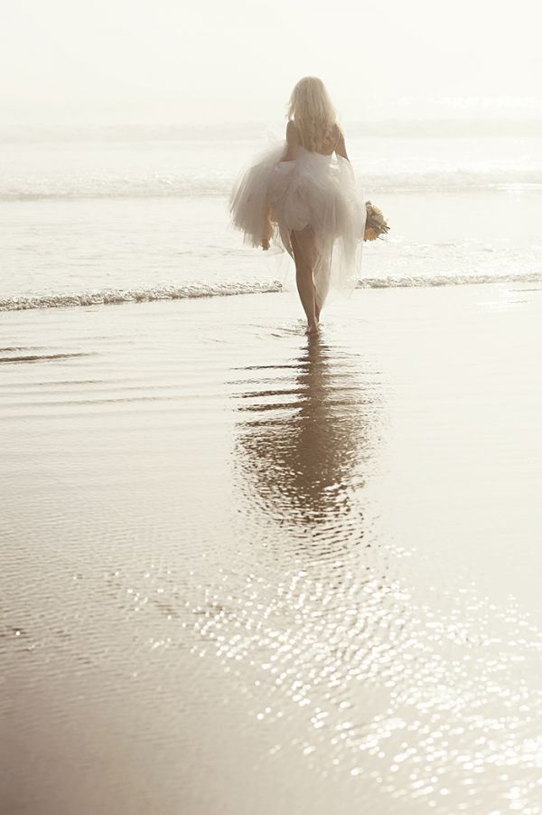 incredible shot of a bride on the beach and other beautiful beach shots in blog.  HEATHER