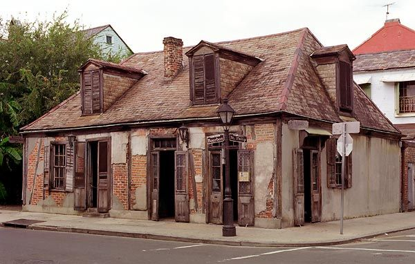 Lafitte's Blacksmith Shop. A pre-1772 blacksmith shop used as the front for a wealthy smuggler, now turned bar with no electricity--all candles! Amazing place.  French Quarter.