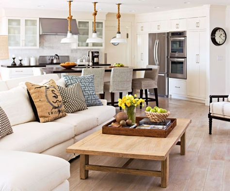 Enlarge the Space with Diagonals // Living Room Furniture Arrangements from BHG.