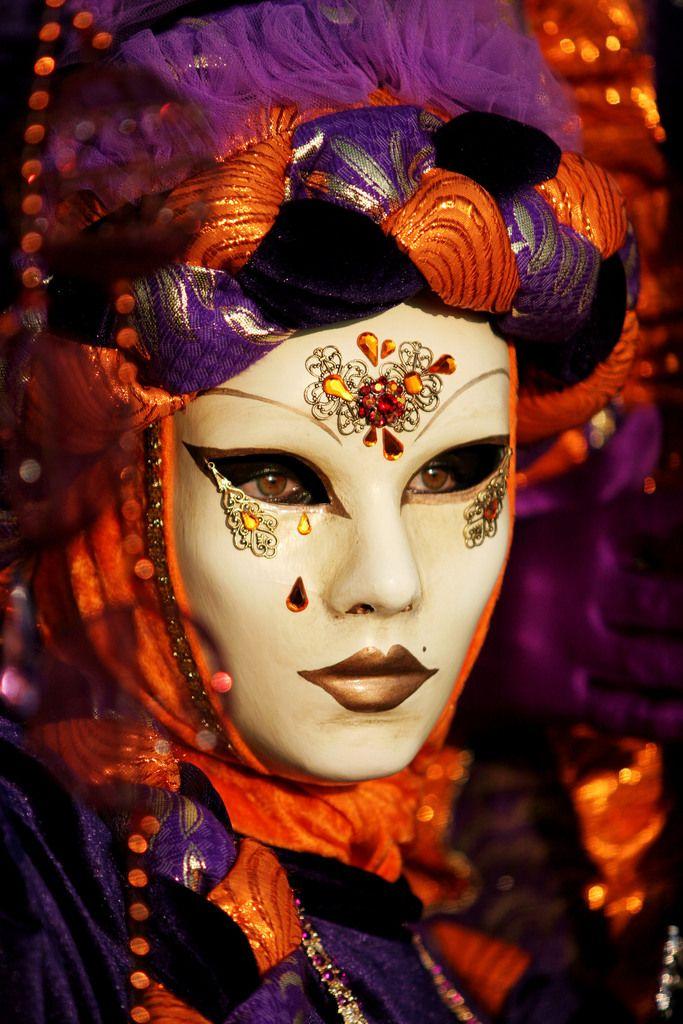 Purple and orange carnival costume with elaborate braided trim