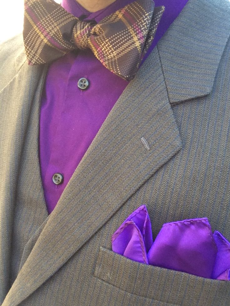Here's an outfit for a nice, cool day the Good Lord made: Purple Dress Shirt ✅ Gray & Blue Striped 3 Piece Suit ✅ Brown & Purple Striped Bow Tie ✅ Purple Pocket Square ✅ Hope this helps you with your outfit choosing; God Bless!
