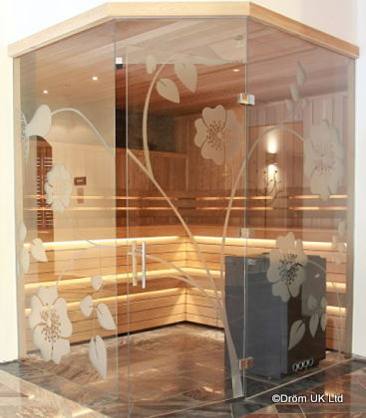 Etched frameless glass finishes this beautiful sauna perfectly. Frameless glass gives the illusion of light and space and enables the bather to see out over the pool or grounds beyond.