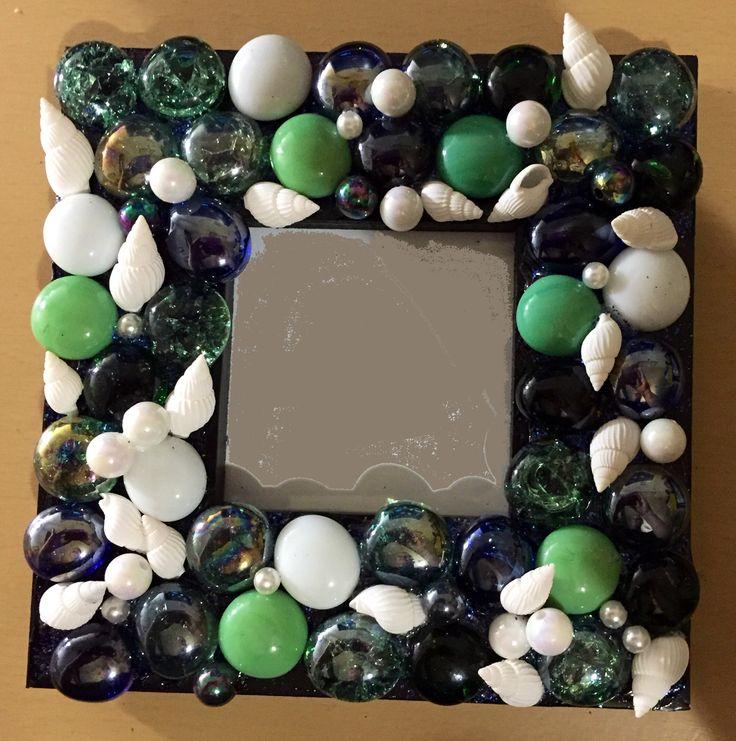 Glass pebbles, sea shells, beads on photo frame