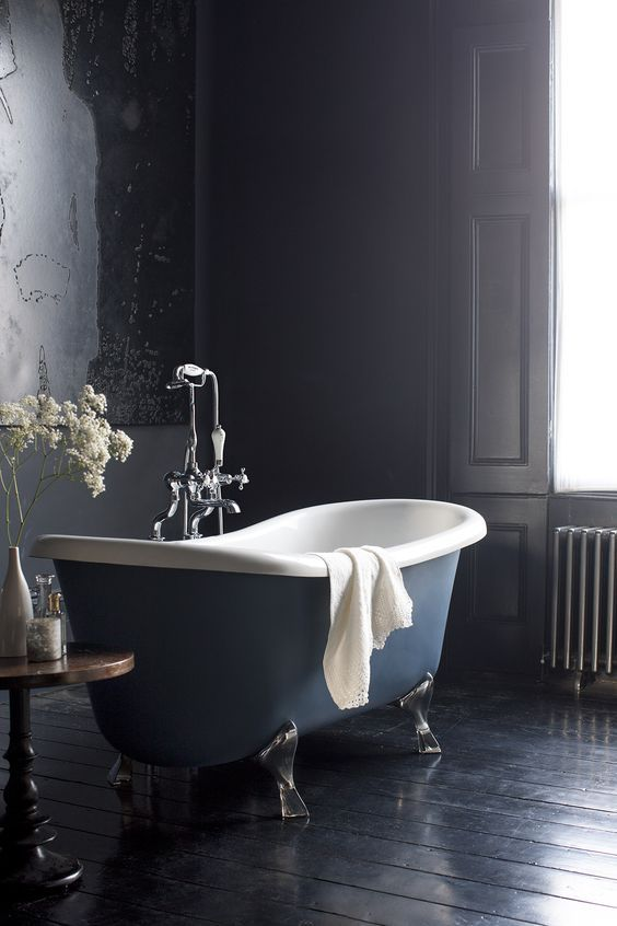 Glamorous bathroom with period details and a wooden floor  - Bateau Bath from Burlington Bathrooms.