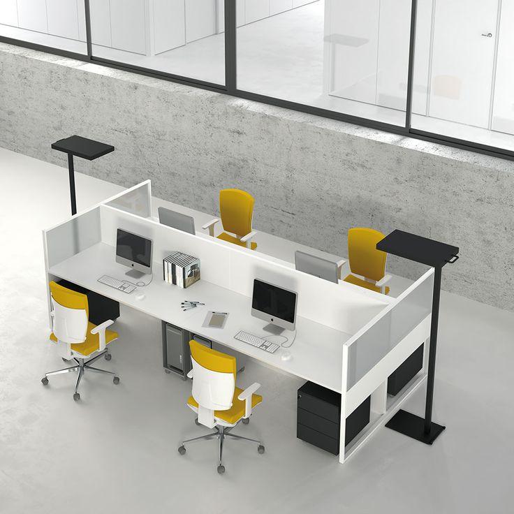 Scrivania Basic Desk by DOIMOffice. I melaminici dei piani spaziano dalla tinta unita alle finiture legno, che insieme alla leggerezza dell'acciaio verniciato nei colori bianco- argento-antracite esaltano il design minimale del sistema.