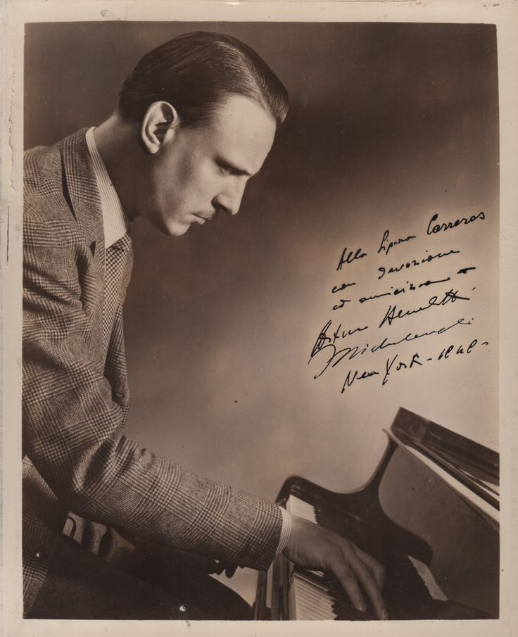 MICHELANGELI ARTURO BENEDETTI: (1920-1995) Italian Classical Pianist, considered one of the greatest pianists of the twentieth century. Vintage signed and inscribed 8 x 10 sepia photograph. The image depicting Michelangeli in a half-length pose, seated at his piano. Signed by Michelangeli in bold blacked fountain pen ink to a clear area of the image, inscribed and dated 1949 in the pianist's hand.