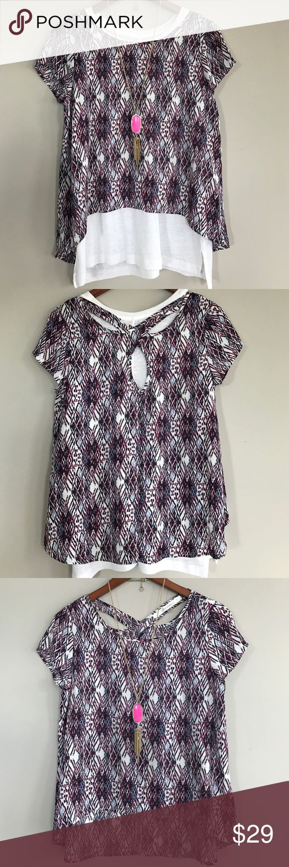 """Stitch Fix Fun 2 Fun cross back short sleeve top EUC, pink, blue and white print, in the first two photos I added a white tank (not included) to show cut outs, measurements taken laid flat: bust 18"""", length in front 20"""", back 25"""" from shoulder to hem Fun 2 Fun Tops"""
