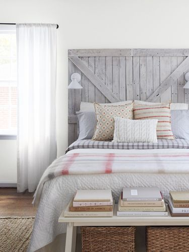 A statement-making barn door headboard adds buckets of country charm to a bedroom.