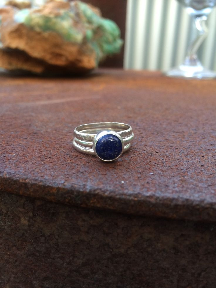 This ring has an 8mm lapis lazuli with a plain bezel on a 1mm half round band The stone of lapis lazuli is so beautiful it looks like a tiny Galaxy,Have your very own Galaxy on your hand :)  Lapis LazuliA stone of truth, assisting to speak ones truth. Place on your third eye to help open your third eye. A very royal stone, formed by multiple minerals including lazurite, sodalite, calcite and pyrite.chakra: Throat and third eye Emotional healing: helps take responsi...