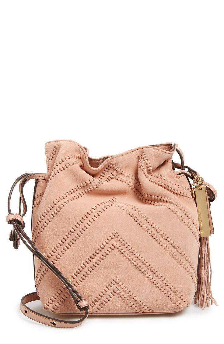 This bucket bag silhouette with chevron detail creates a boho look with its pastel pink color and smooth suede.