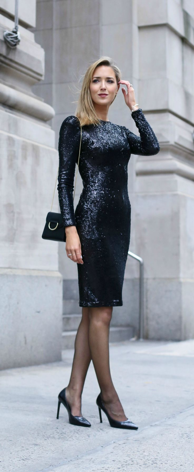 long sleeve black sequin cocktail dress, perfect for a dressy night out at the theater