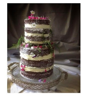 2 tiers of couverture chocolate w organic vanilla bean buttercream. Simply dusted w icing sugar and some sweet edible flowers from my garden  #happy #engagement #gillianbell #organic #cake #brisbanewedding