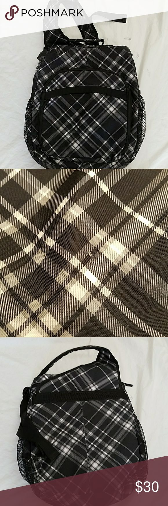 Thirty-one black grey plaid swing pack backpack Up for sale is a lightly-used bag that has removable compartments period it measures 13.5 inches wide by 16 inches tall. There is one little teeny superficial Mark in front... very clean thirty -one Bags