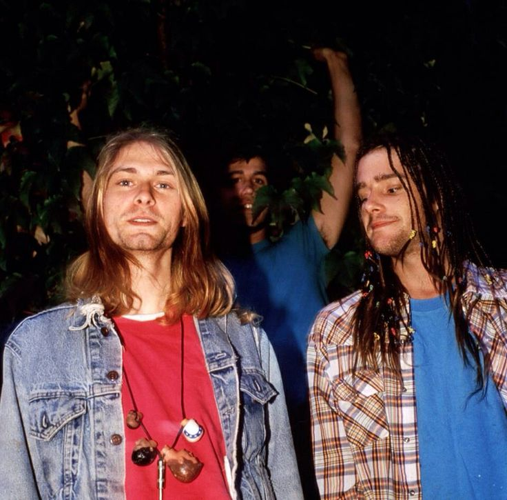 Chad Channing presumably staring at Kurt's unusual necklace of ?Ken doll heads... Kurt, ever the doll-lover
