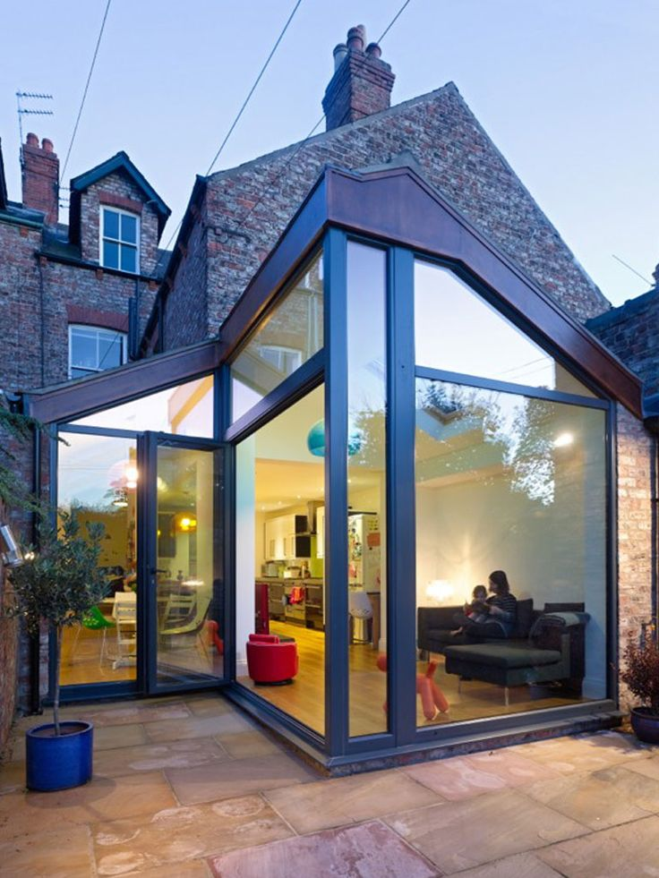 This design incorporated the use of glass to add as much light to the new kitchen and living space conversion.