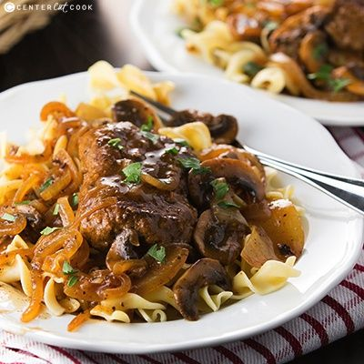 Salisbury Steak with mushrooms and onions served with gravy over noodles or rice is comfort food at its finest! Salisbury Steak is a classic, and so easy to make!