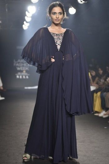 3cecec804595 Julie by Julie Shah Featuring a navy blue cape jumpsuit in viscose  georgette base with floral embroidery and one side long sleeve.