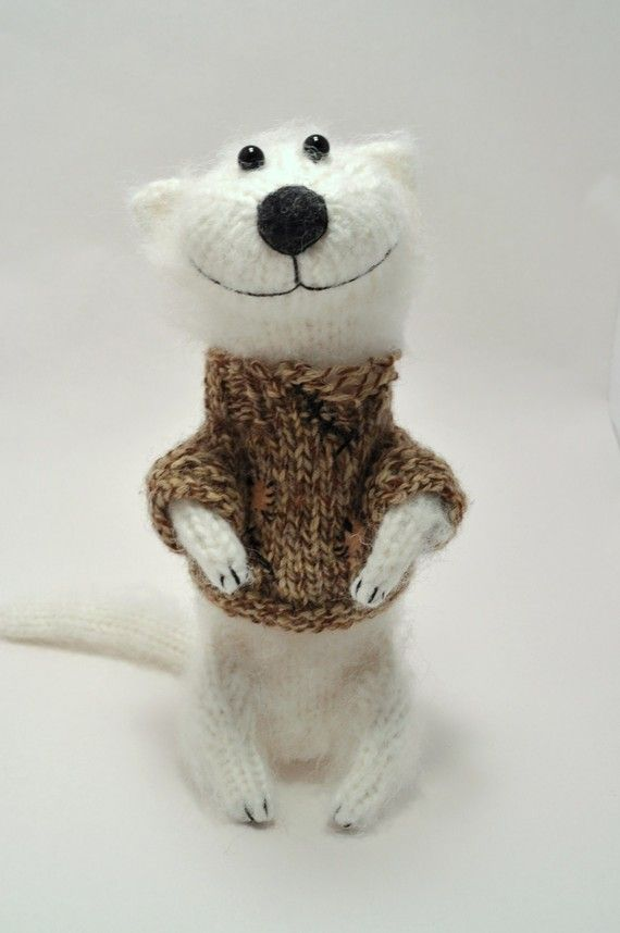Ha ha.  This adorable knitted toy makes me laugh! <3