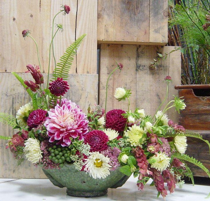 Everything. Flowers, ferns and playful asymmetry. #arrangement