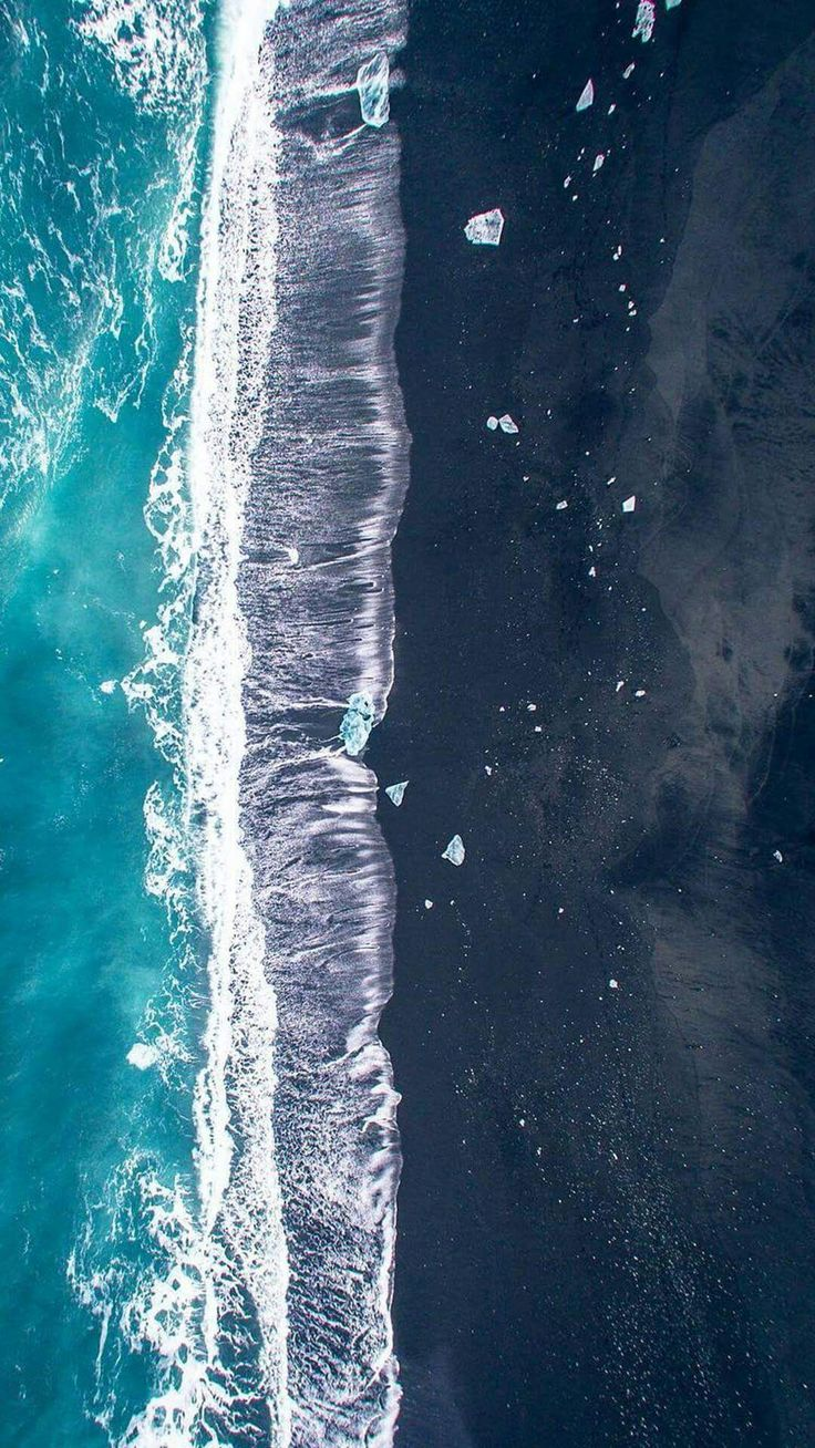 Aerial ocean and beach scene.