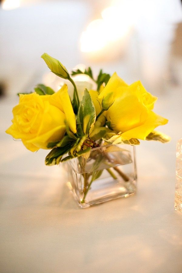yellow-centerpieces simple and small scale add the L etched in vase.....