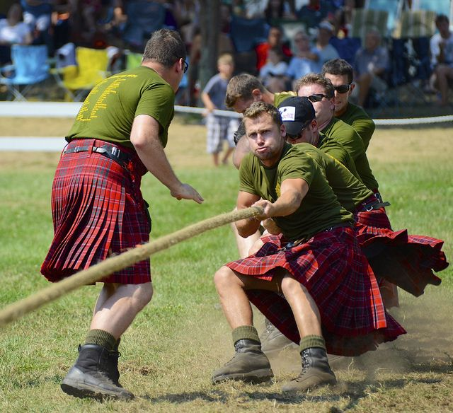 The photo captures soldiers of the Lake Superior Scottish Regiment, Canadian Army Reserves, pulling against other teams from the Canadian Army's reserve highland regiments during the Glengarry Highland Games, in Maxville Ontario.