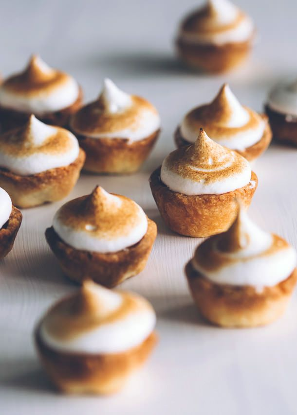 MINI LEMON-MERINGUE TARTS | ITALIAN MERINGUE Makes 20-24. 3 egg whites, 150g caster sugar, 100ml water. Put egg whites in mixer bowl. Boil sugar & water to 115c with candy thermometer. Start whisking eggs. When syrup at 121C, remove, let bubbles settle, slowly pour down side of mixer bowl into eggs – don't touch whisk. Keep whisking until cool to touch and meringue smooth & glossy. Pipe onto lemon curd tarts. Use kitchen blowtorch to lightly scorch.