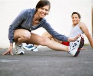 Woman and man stretching Health and fitness tracking devices