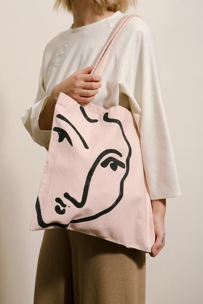 Handmade tote inspired by Matisse's 'Nadia au Menton Pointu.' Sturdier than the usual cotton tote, this bag is made from a thick and durable organic cotton and has been hand dyed in blush, then carefully sewn and hand painted. The perfect carryall for the