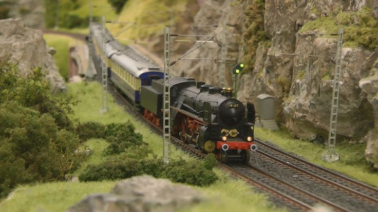 Model railroad layout in HO scale with steam locomotives and steam trains - YouTube