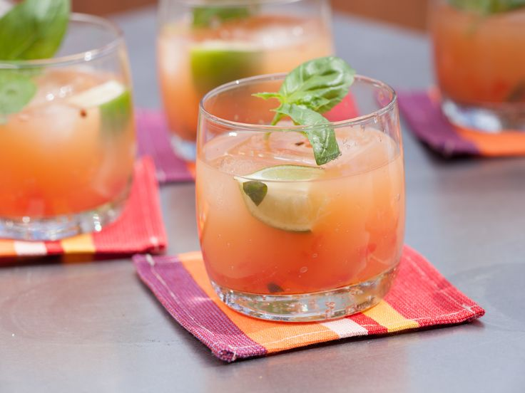 Grand Marnier and watermelon puree combine swimmingly in this rum punch. Pin it now for your summer parties.