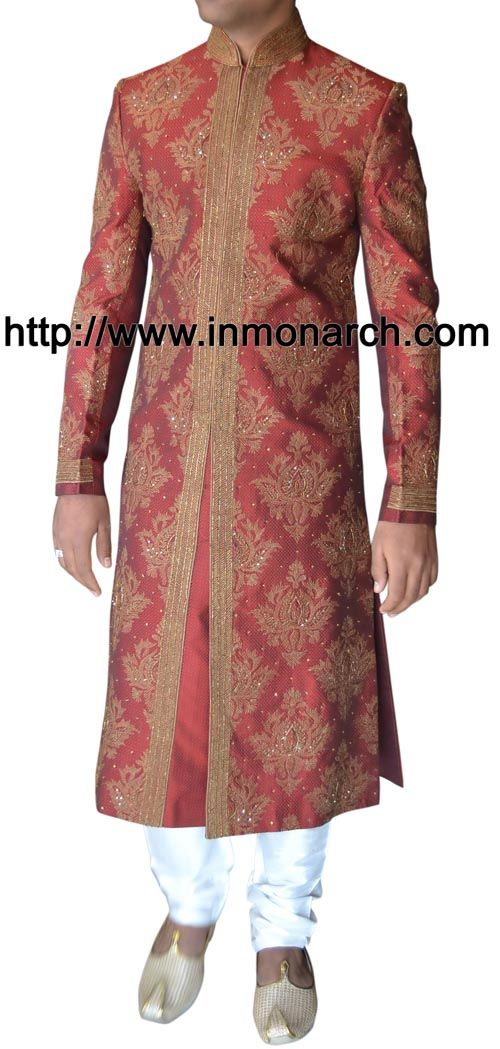 Fancy work designer Indian groom sherwani made from crimson red color brocade fabric. Hand embroidered as shown. It has bottom as chudidar made from dupion fabric in white color.