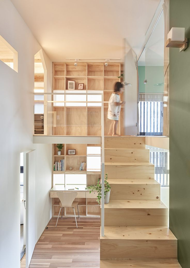 Taiwan apartment renovation by Hao Design includes walk-in wardrobe on a mezzanine level