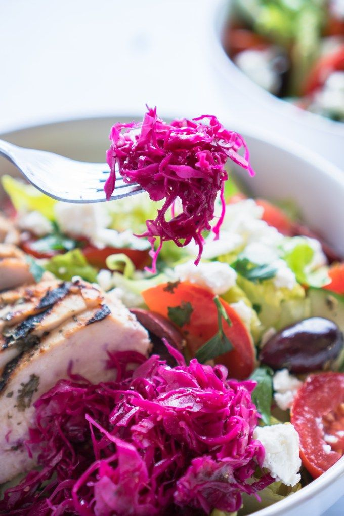 Pickled Red Cabbage – Simple recipe for Pickled Red Cabbage! Thinly sliced cabbage marinated in red wine vinegar, lemon juice, apple cider vinegar, sugar, salt, pepper and smashed garlic cloves. We love this on Mediterranean salad bowls and in grilled chicken pita pockets! ♥ | freeyourfork.com