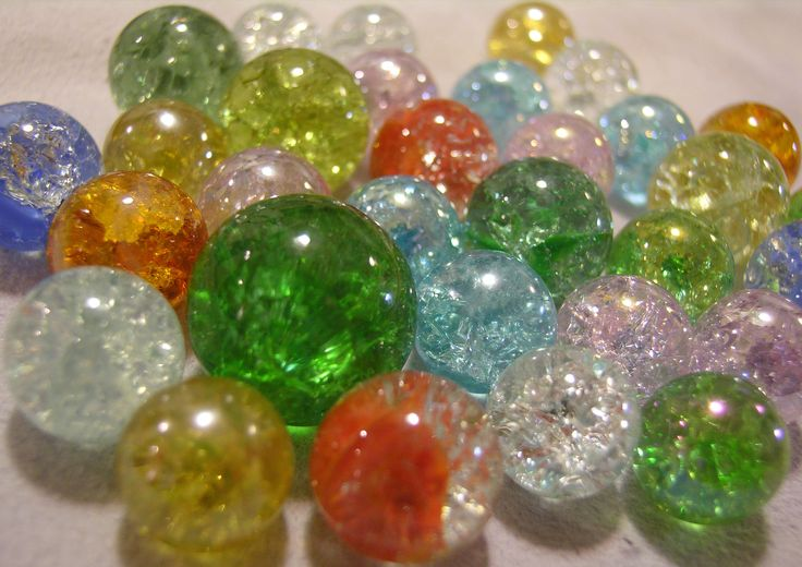 """""""Mama told me about frying marbles for 20 minutes and then plunging them into ice water.  If all goes well, the marbles shatter inside while keeping their form and look like this.  I've been making pendants out of the ones we fried."""" - Never would have thought of that!"""