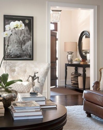 long entryway table with pair of mercury glass lamps. check out the tall pottery barn lamps
